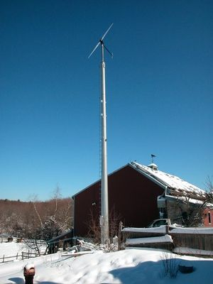 this southwest windpower whisper 175 wind turbine on the lion spring farm  in dover, massachusetts, supplies electricity for the house and barn
