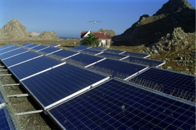 Photo of PV panels on a rocky island.